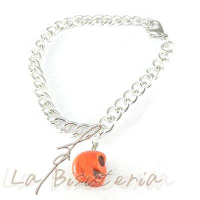 detalle pulsera calaveras naranja